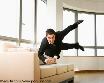 Businessman Jumping On Sofa Funny Business Picture